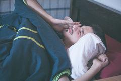 young-man-wake-up-morning-rub-eyes-stretch-89053809